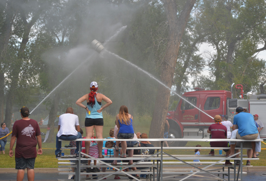 Justin Sheely | The Sheridan Press<br /> People watch as teams try to push the suspended barrel with water during the annual Firemen's Water Fight Saturday at Scott Park in Dayton.