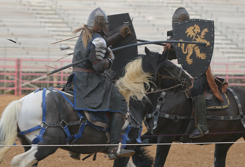 "Justin Sheely | The Sheridan Press<br /> Performers Jeremy ""Sir Rowan"" Johnson, left, and Zach ""Sir Zachary"" Lovering break their lances as they joust during the Knights of the Order of Epona tournament Saturday at the Sheridan County Fairgrounds. The event benefited CHAPS Equine Assisted Therapy in Sheridan."