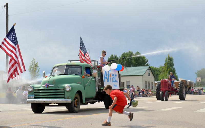 Justin Sheely | The Sheridan Press<br /> The parade rides down Dayton's main street during the annual Dayton Days Parade on Saturday.