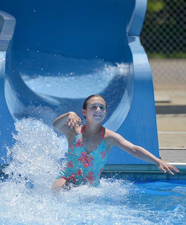 Justin Sheely | The Sheridan Press<br /> Eleven-year-old Hayley Curtis splashes out of the waterslide Wednesday at Kendrick Pool. The pool is open 1 - 7 p.m. daily, Sunday admission is only $1. The pool closes for the season August 26.