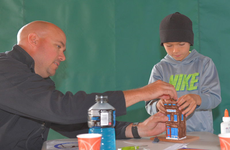 Justin Sheely | The Sheridan Press<br /> Brent Moore helps his son Grayson Moore, 8, with a craft activity representing a general story in celebration of the town of Clearmont's 125 year anniversary during Tidbit Tuesday at the Sheridan County Museum. Town Clearmont Mayor Chris Schock gave a presentation on the town's history during the event. Clearmont is hosting an all-day celebration this Saturday.
