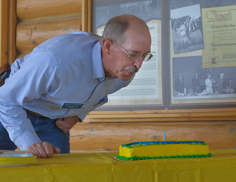 Justin Sheely | The Sheridan Press<br /> Town of Clearmont Mayor Chris Schock blows out a birthday cake candle in celebration of Clearmont's 125 year anniversary during Tidbit Tuesday at the Sheridan County Museum. Schock gave a presentation on the town's history during the event. Clearmont is hosting an all-day celebration this Saturday.
