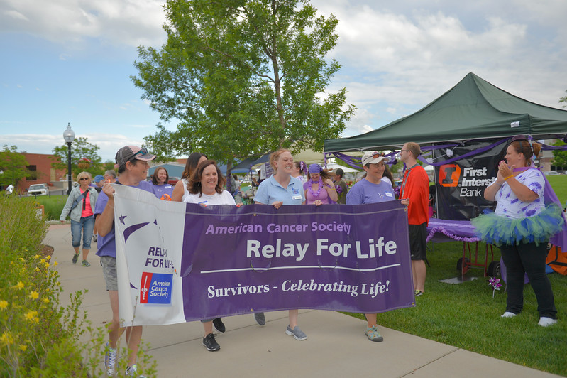 Justin Sheely | The Sheridan Press<br /> Cancer survivors walk their laps during the annual Relay for Life event Saturday at Whitney Commons Park.