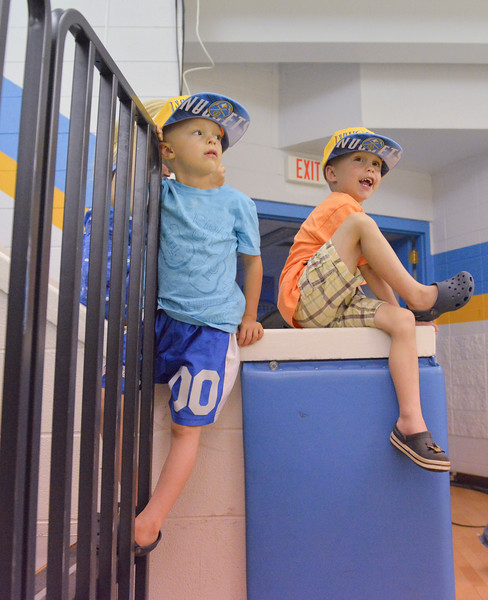 Justin Sheely | The Sheridan Press<br /> Four-year-old twin brothers Eli and Abe Marshall play on the stairs during the Wyoming vs Montana All-Star Game Friday at the Golden Dome.