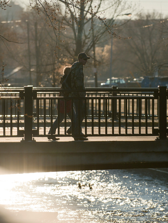 Justin Sheely | The Sheridan Press<br /> People cross the Little Goose Creek in downtown Sheridan Friday morning.
