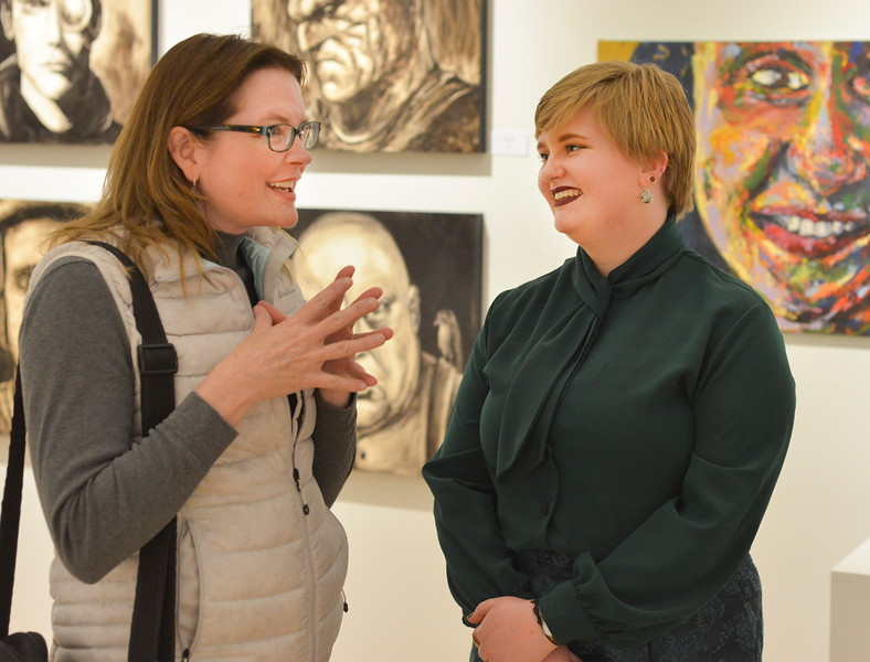 "Justin Sheely | The Sheridan Press<br /> Kati Sherwood, left, visits with her former college art classmate Jenna Jordan during the artist reception for ""Modern Masters"" art show Thursday evening at SAGE Community Arts on Brundage Street. The gallery features work by Micah Trampe and Jenna Jordan. The gallery is open to the public through April 14, hours are 10 a.m. to 5 p.m., Tuesday through Friday."