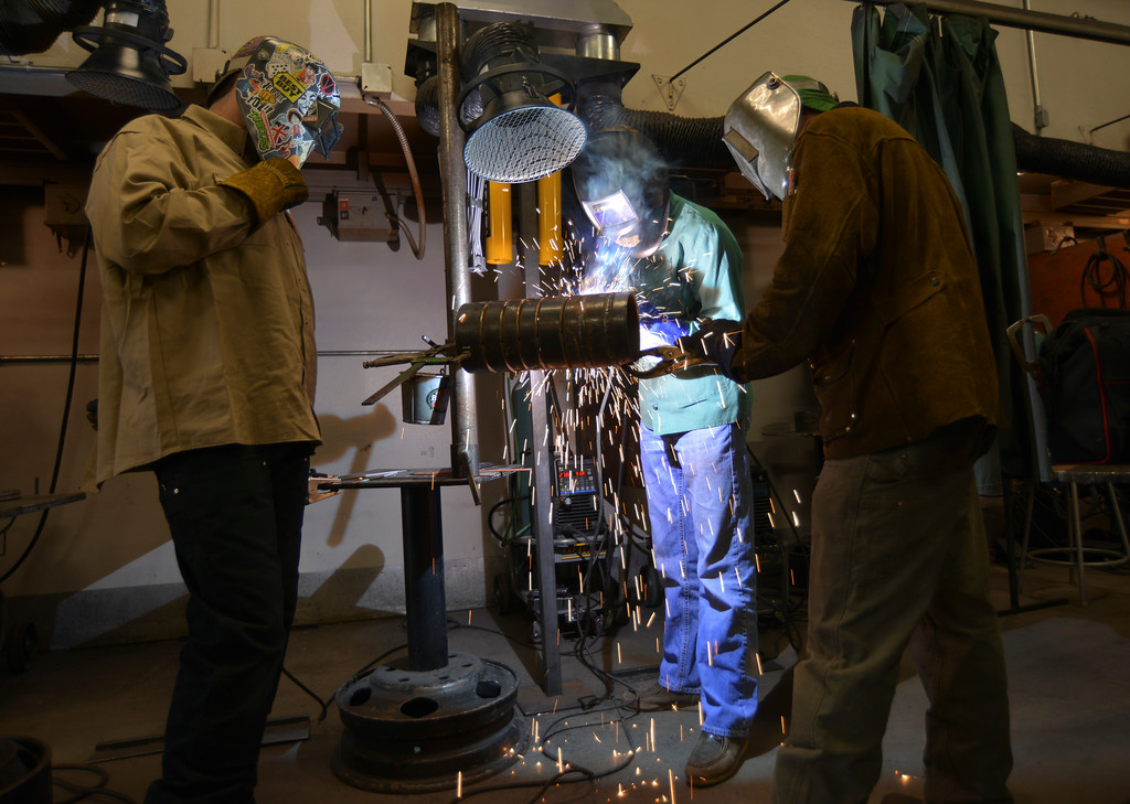 Justin Sheely | The Sheridan Press<br /> Welding students, from left, Chris Daniels, Ethan Hines and Jaden Paddock perform a shielded metal arc weld on a pipe during the Industrial Technology Programs Demo Day Wednesday in the Technical Center at Sheridan College. The event was open to high school students and teachers in industrial technology. College students held demonstration in areas of welding, diesel, machine tool and construction.