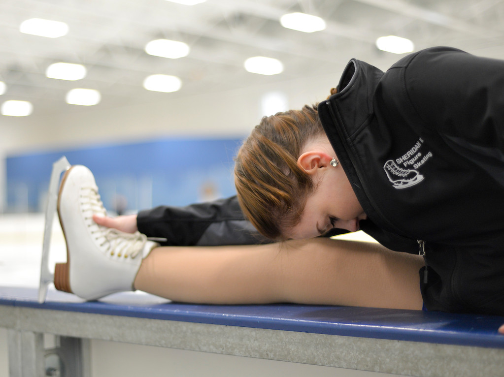 Justin Sheely | The Sheridan Press<br /> Molly Butler stretches during the dress rehearsal Monday for Sheridan Ice's 8th annual Ice Show at Whitney Rink in the M&M's Center. The figure skating show is free and open to the public on Tuesday, March 21, at 6:30 p.m. in the M&M's Center.