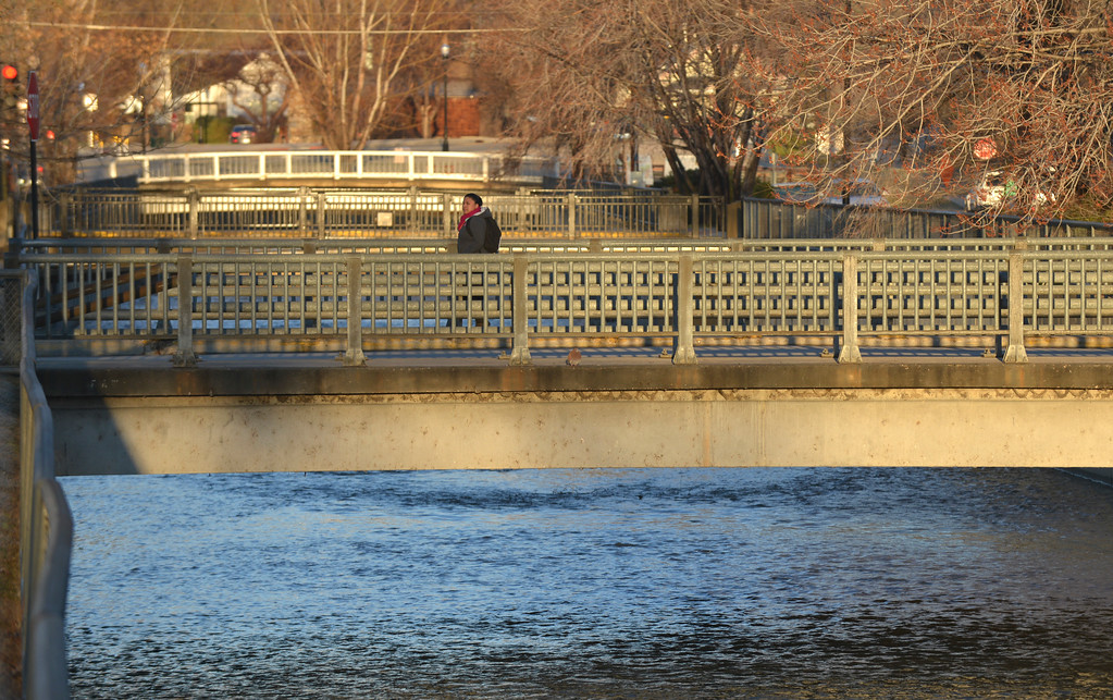 Justin Sheely | The Sheridan Press<br /> A person walks on a bridge over the Little Goose Creek in downtown Sheridan Friday morning.
