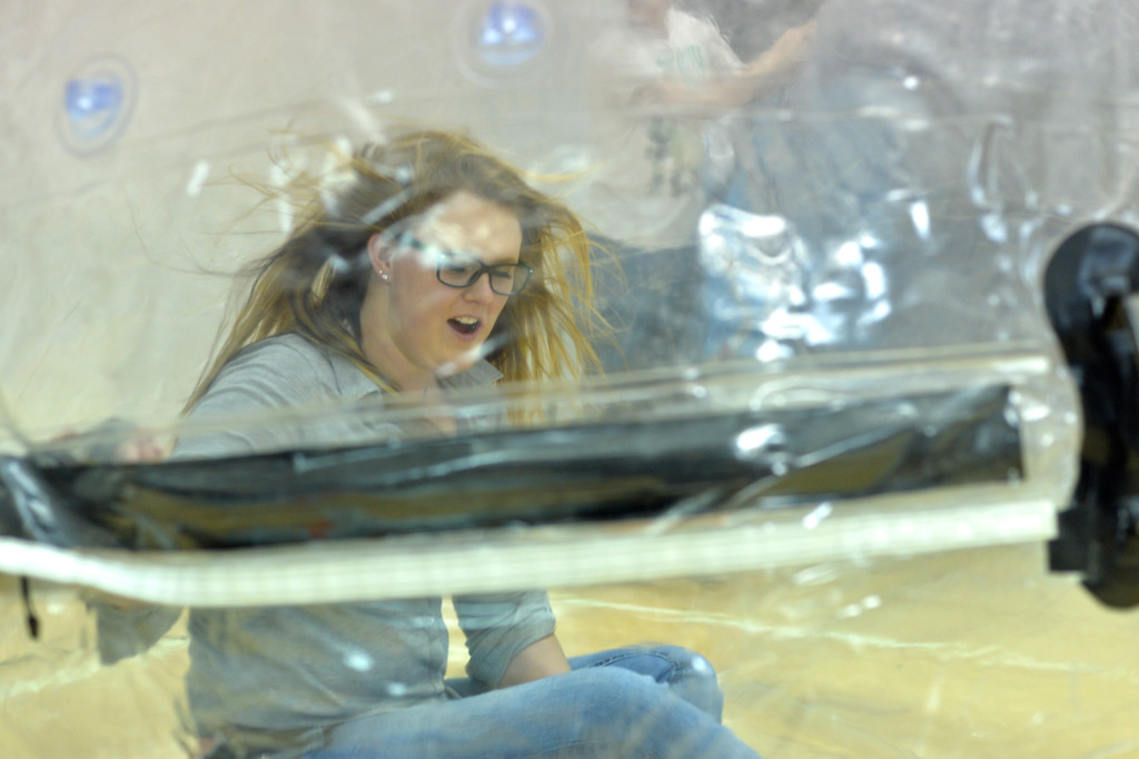 Justin Sheely | The Sheridan Press<br /> College student Kayla Conner sits inside a giant orb as it is inflated during the carnival Saturday in the Bruce Hoffman Golden Dome at Sheridan College.