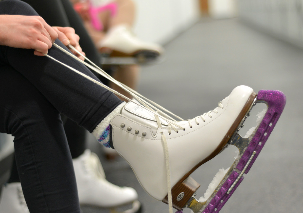 Justin Sheely | The Sheridan Press<br /> A figure skater tightens her skates during the dress rehearsal Monday for Sheridan Ice's 8th annual Ice Show at Whitney Rink in the M&M's Center. The figure skating show is free and open to the public on Tuesday, March 21, at 6:30 p.m. in the M&M's Center.