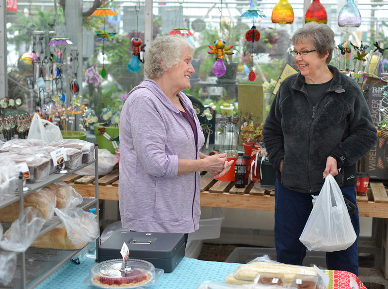 Justin Sheely | The Sheridan Press<br /> Local baker Lorean Newbrough chats with customer Barbara Katz during the Farmers Market Saturday at Landon's Greenhouse. The market has been running throughout the winter and spring every Saturday from 10 a.m. to noon.