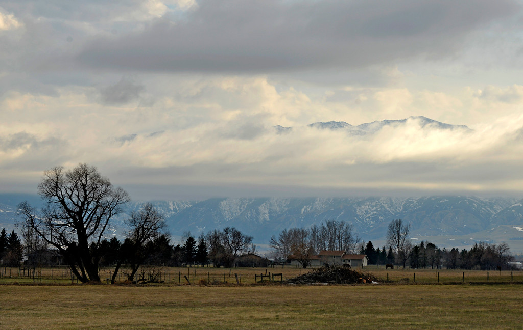 Justin Sheely | The Sheridan Press<br /> Clouds break in front of the face of the Bighorn mountains Tuesday morning near Big Horn. Rain is expected on Thursday followed by sunny weather into the weekend.