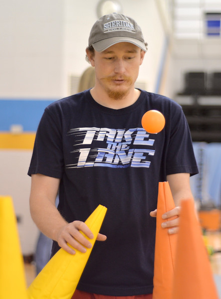 Justin Sheely | The Sheridan Press<br /> College student John Elsom plays a game relaying floating balls during the carnival Saturday in the Bruce Hoffman Golden Dome at Sheridan College.