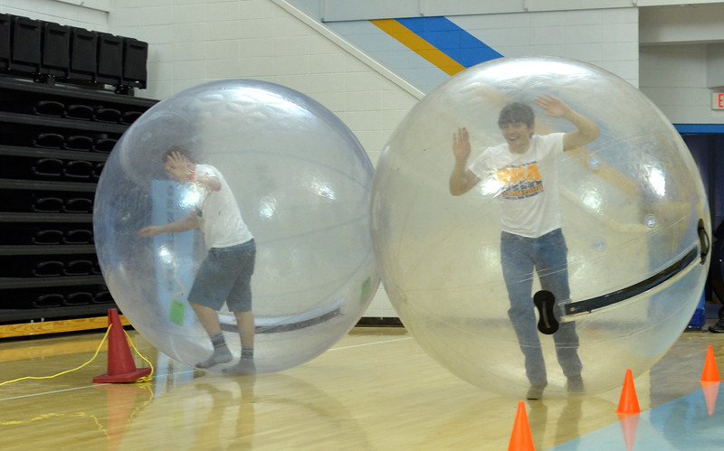 Justin Sheely | The Sheridan Press<br /> College students Austin Johnson, left, and Carson Haun race each other inside giant inflatable orbs during the carnival Saturday in the Bruce Hoffman Golden Dome at Sheridan College.