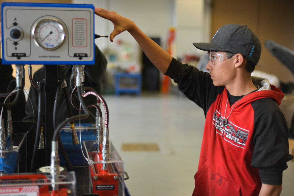 Justin Sheely | The Sheridan Press<br /> Dylan Scott, a junior high school student from Greybull, activates a hydraulic cylinder training system for testing engine cylinders during the Industrial Technology Programs Demo Day Wednesday in the Technical Center at Sheridan College. The event was open to high school students and teachers in industrial technology. College students held demonstration in areas of welding, diesel, machine tool and construction.