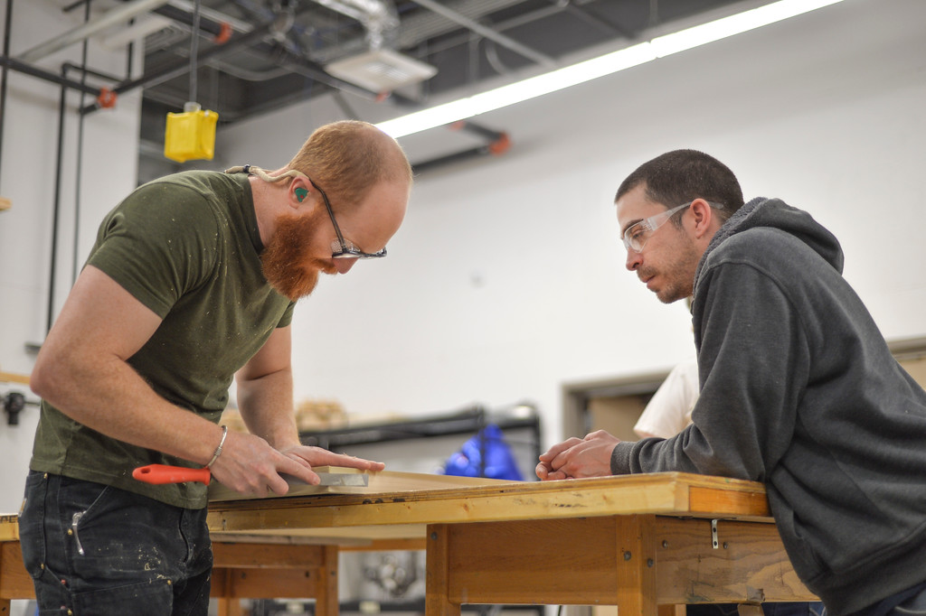 Justin Sheely | The Sheridan Press<br /> Instructor Jason Lanka, left, shows art student Jonathan Kibodeaux how to file down the corners of a frame during a frame building session Thursday in the Whitney Center for the Arts at Sheridan College. Art students are gearing up for the upcoming student juried show. Instructor Jason Lanka says that students are being held to professional gallery standards. Students will learn the process of making custom frames for their art and how to properly display them.