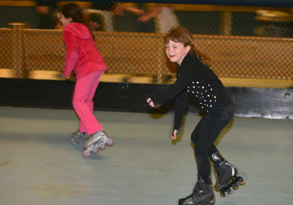 Justin Sheely | The Sheridan Press<br /> First-grader Stella Dalton glides across the floor during the YMCA's Big Horn Fun Day program at Scotty's Skate Castle Friday morning. The YMCA offers fun activities for children who go to Big Horn schools since Sheridan County School District 1 does not hold class on Fridays.