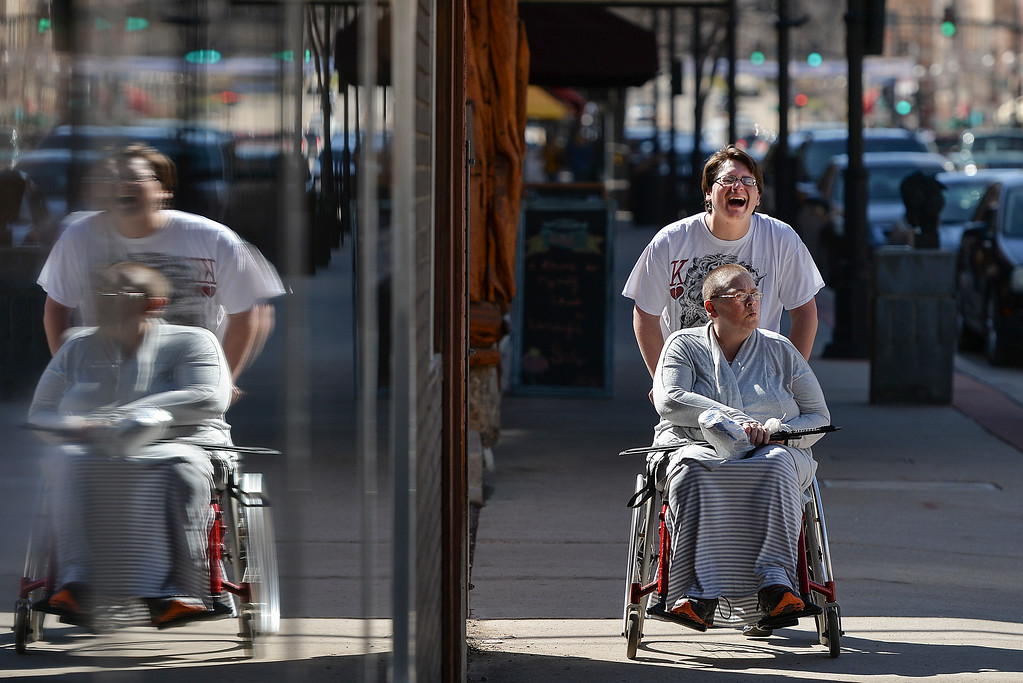Justin Sheely | The Sheridan Press<br /> David Chadwick takes his mother Kit Chadwick shopping on a warm Wednesday morning on Sheridan's Main Street. Chadwick says he takes his mother out when the weather is nice.