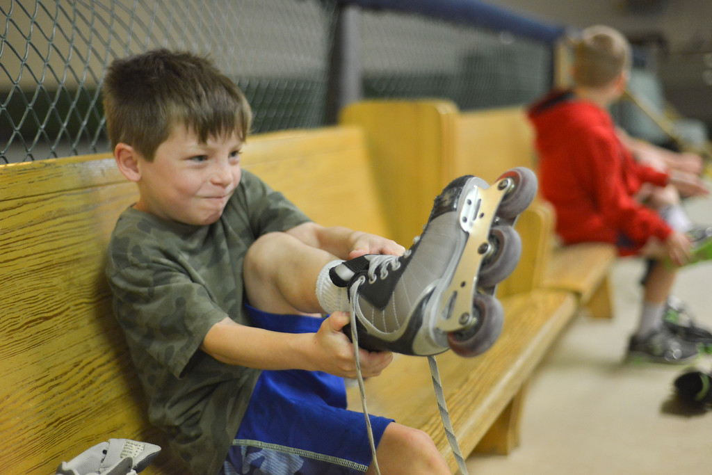 Justin Sheely | The Sheridan Press<br /> First-grader Blaine Fancher pulls on a pair of skates during the YMCA's Big Horn Fun Day program at Scotty's Skate Castle Friday morning. The YMCA offers fun activities for children who go to Big Horn schools since Sheridan County School District 1 does not hold class on Fridays.