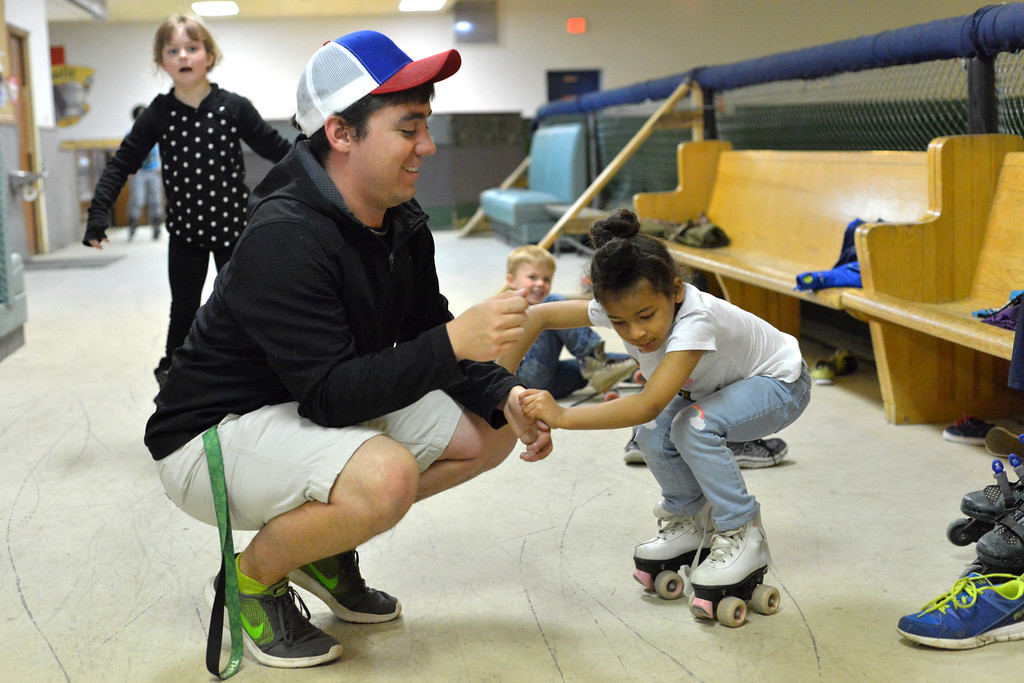Justin Sheely | The Sheridan Press<br /> YMCA staff member Tyler Rogers helps kindergartener Treasure Schimka on her feet during the YMCA's Big Horn Fun Day program at Scotty's Skate Castle Friday morning. The YMCA offers fun activities for children who go to Big Horn schools since Sheridan County School District 1 does not hold class on Fridays.
