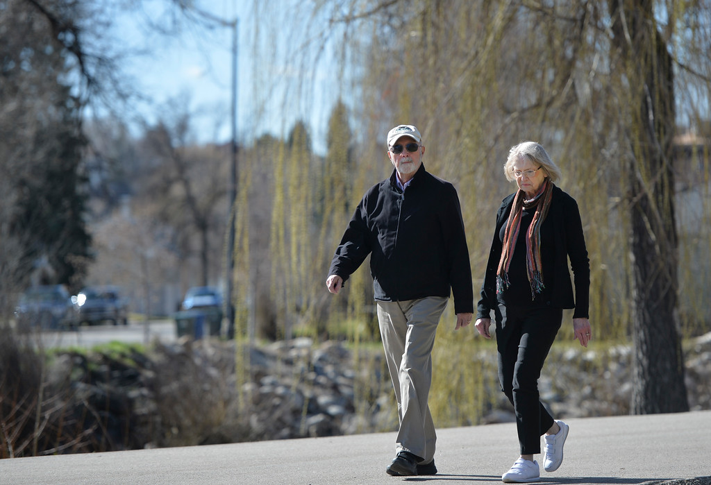 Justin Sheely | The Sheridan Press<br /> John Meyer and Dee Meyer walk through Kendrick Park on a sunny Wednesday morning. The next several days hold chances for rain with possibility for snow.