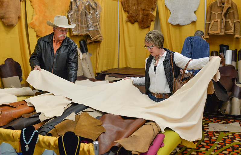 Justin Sheely | The Sheridan Press<br /> Kyle and Cindy Butts of Gillette, Wyoming, look at sheep skin during the annual Rocky Mountain Leather Crafters Trade Show Friday at the Sheridan Inn Convention Center.