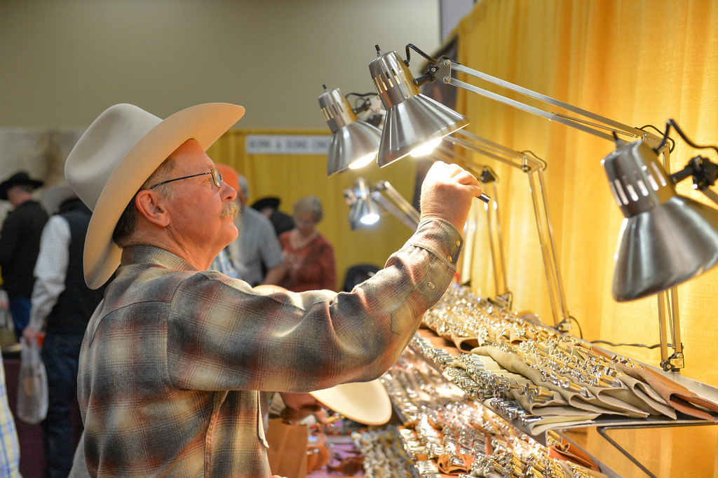 Justin Sheely | The Sheridan Press<br /> Dan cushman of Lusk, Wyoming, looks at leather tools during the annual Rocky Mountain Leather Crafters Trade Show Friday at the Sheridan Inn Convention Center.