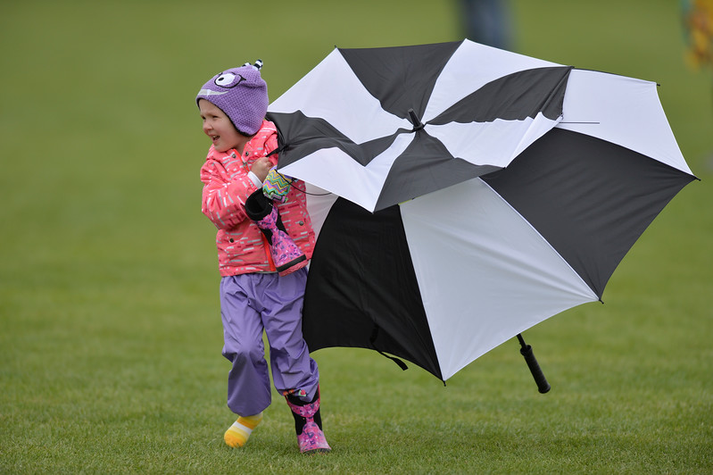 Justin Sheely | The Sheridan Press<br /> Two-year-old McKenna Matson retrieves her umbrella as her father coaches the Campbell County Lady Camels team during the girls class 4a State Championship semifinals game against Cheyenne Central Friday at the Big Horn Equestrian Center.