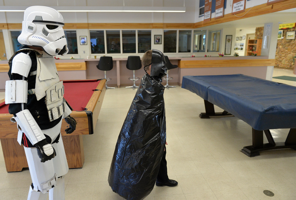 Justin Sheely | The Sheridan Press<br /> Jason Barron wears his homemade stormtrooper costume as his brother Kolbe Barron dressed as Darth Vader using a garbage bag during the Mother and Son Star Wars Date Night Friday at the Tongue River Community Center. The Star Wars themed event was to provide a fun opportunity for moms and their sons for Mother's Day Weekend.
