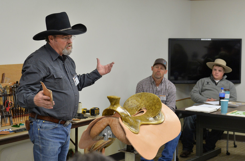Justin Sheely | The Sheridan Press<br /> Seither Seidel of Cody, Wyoming, talks about ground seat fundamentals for saddle making during a workshop for the Rocky Mountain Leather Crafters convention Thursday at Sheridan College. The week-long annual convention draws tradesmen and women from across the globe to Sheridan Wyoming to learn techniques and skills in leather crafting, shaping and tooling.