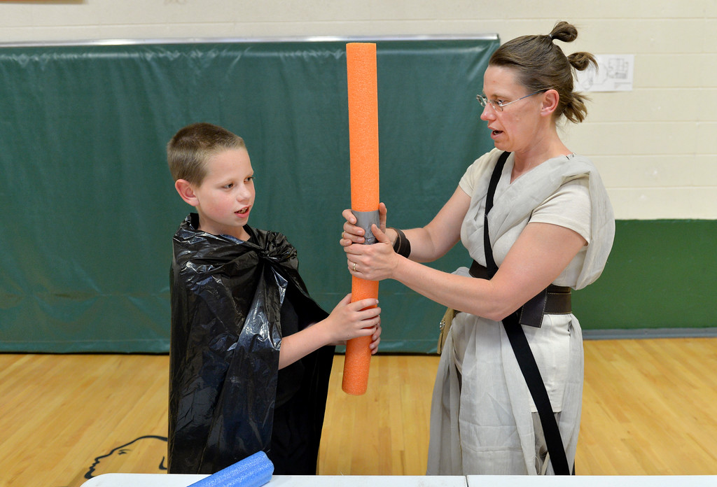 Justin Sheely | The Sheridan Press<br /> Monique Barron, right, helps her son Kolbe Barron make a noodle light saber during the Mother and Son Star Wars Date Night Friday at the Tongue River Community Center. The Star Wars themed event was to provide a fun opportunity for moms and their sons for Mother's Day Weekend.