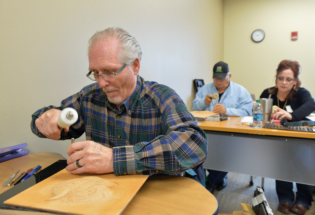 Justin Sheely | The Sheridan Press<br /> Workshop participant Dennis Bloxham of Livingston, Montana, hammers away for an extreme embossing workshop during the Rocky Mountain Leather Crafters convention Thursday at Sheridan College. The week-long annual convention draws tradesmen and women from across the globe to Sheridan Wyoming to learn techniques and skills in leather crafting, shaping and tooling.