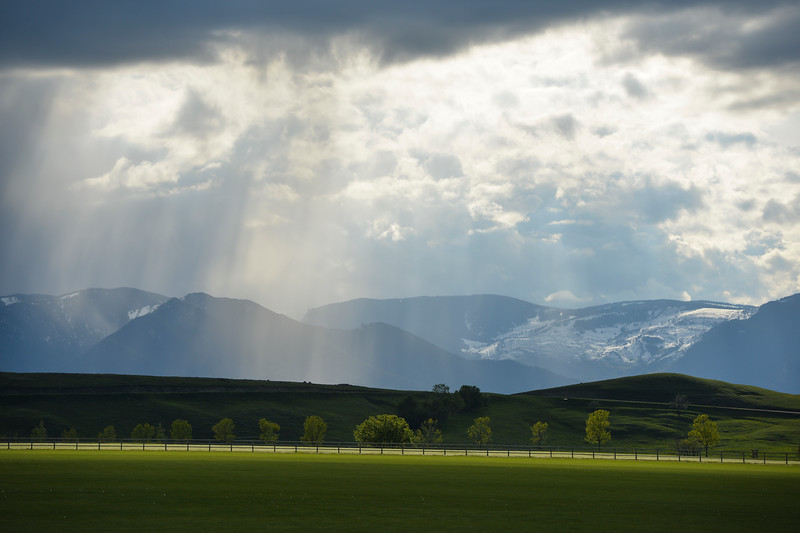 Justin Sheely | The Sheridan Press<br /> Rays of sunlight break through the clouds over the Bighorn Mountains Saturday at the Big Horn Equestrian Center.
