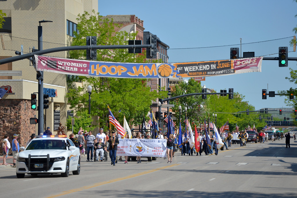 Justin Sheely | The Sheridan Press<br /> Parade participants march during the Memorial Day Parade Monday on Main Street.
