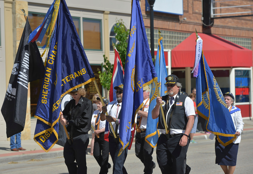 Justin Sheely | The Sheridan Press<br /> Flag bearers of local veteran chapters march during the Memorial Day Parade Monday on Main Street.