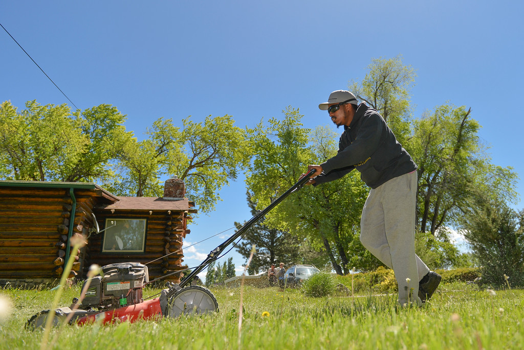 Justin Sheely | The Sheridan Press<br /> Raising Men Lawn Care Service founder Rodney Smith Jr. of Huntsville, Alabama,  runs his lawnmower over the grass Thursday at a resident's home on Big Horn Avenue in Sheridan. Smith will mow one lawn in each of the 50 states of the union to motivate youth in helping their neighbors and community. Raising Men Lawn Care Service offers a 50-Yard challenge that rewards kids with a T-shirt for every 10 yards mowed and a new lawn mower when they hit 50 lawns completed.
