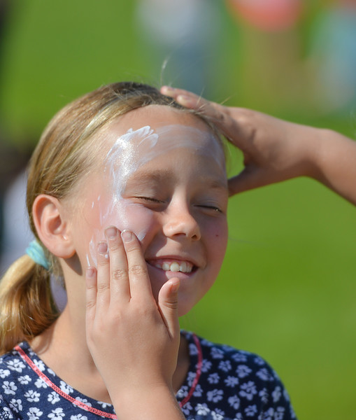 Justin Sheely | The Sheridan Press<br /> Third-grader Macey Homela has a friend help her with sunscreen during the end of school play day Wednesday at Tongue River Elementary School. The play day celebrates the end of the school year and was themed around school principal Hofmeier – who retires this week.