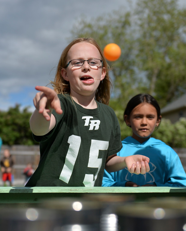 Justin Sheely | The Sheridan Press<br /> Nine-year-old Erika Stutzman tosses a ball at a set of cans to win a prize as Kaydence Morris watches during the After School Carnival celebration Thursday at the Tongue River Valley Community Center in Ranchester. The TRVCC offers an after school program for students in the Tongue River valley area.