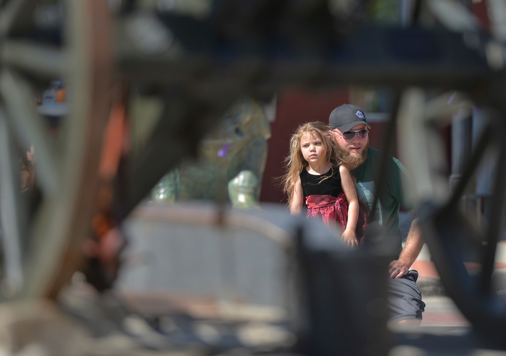 Justin Sheely | The Sheridan Press<br /> Five-year-old Rylee King and Levi King watch parade floats pass during the Memorial Day Parade Monday on Main Street.