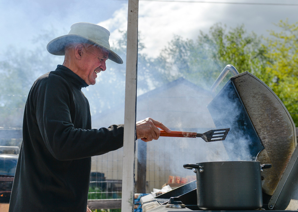 Justin Sheely | The Sheridan Press<br /> Greg Morris flips burgers during the After School Carnival celebration Thursday at the Tongue River Valley Community Center in Ranchester. The TRVCC offers an after school program for students in the Tongue River valley area.