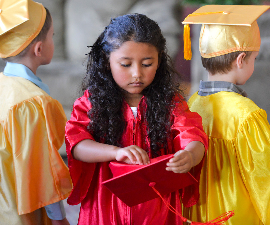 Justin Sheely | The Sheridan Press<br /> Jessica Almaraz tries to fix her cap as graduates line up outside the doors during the Children's Center annual Preschool Graduation Tuesday at Sheridan Wesleyan Church. The Children's Center had 35 students graduate, which is the largest group the preschool held.