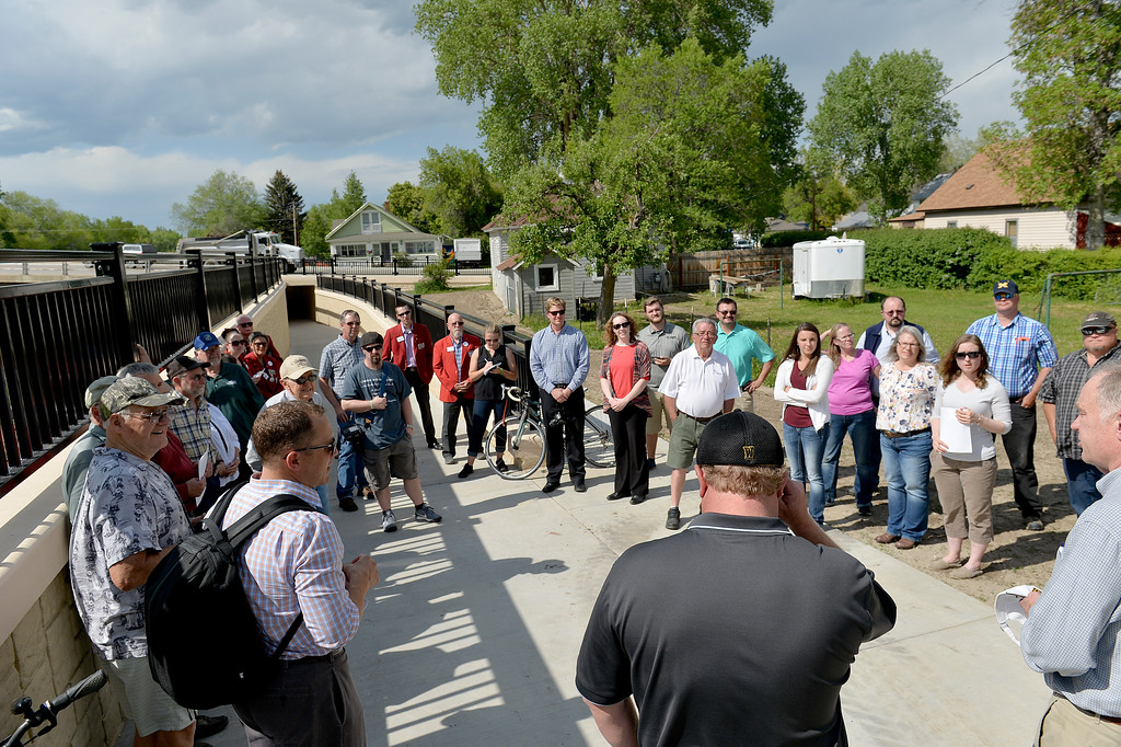 Justin Sheely | The Sheridan Press<br /> Community members, City officials and neighbors gather during the ribbon cutting ceremony of the pedestrian underpass at 5th Street. Mayor Wilson started the pathway system during his time in office. The $2.2 million underpass connects 8.5 miles of pathway with 10.5 miles of the pathway system. Previously pedestrians and bicyclists has to go down to Val Vista to safely cross 5th Street.