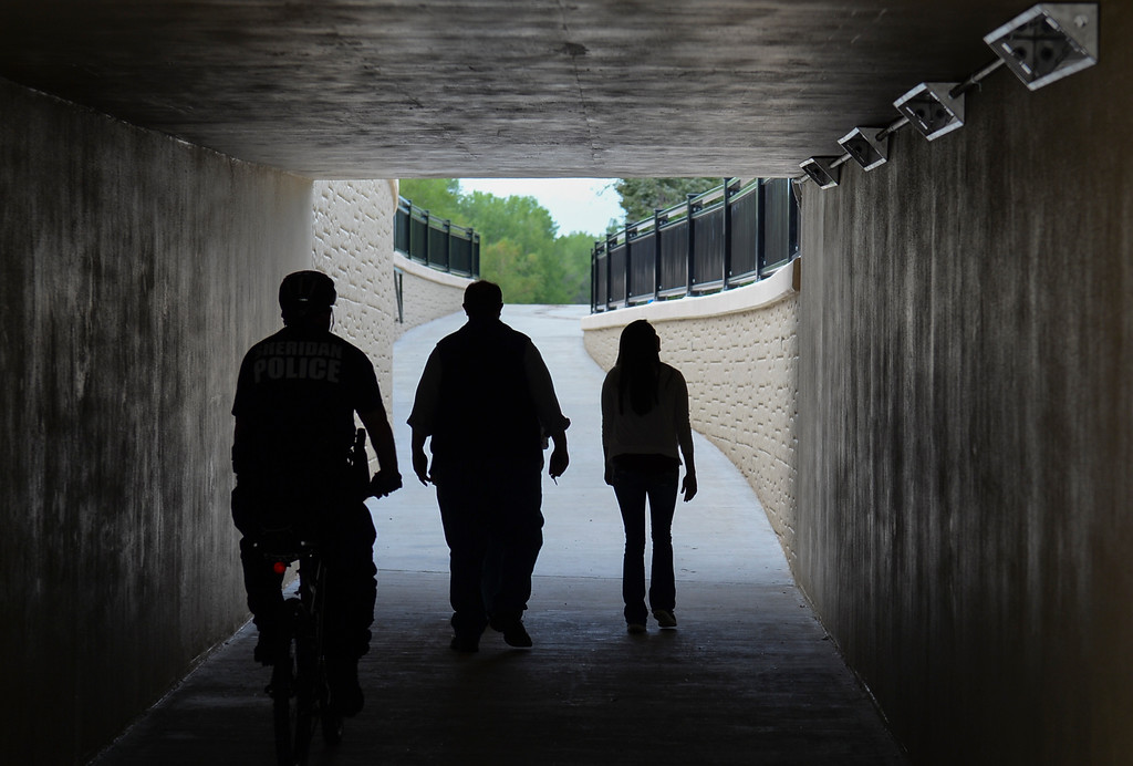Justin Sheely | The Sheridan Press<br /> People walk under 5th Street during the ribbon cutting ceremony of the pedestrian underpass at 5th Street. The $2.2 million underpass connects 8.5 miles of pathway with 10.5 miles of the pathway system. Previously pedestrians and bicyclists has to go down to Val Vista to safely cross 5th Street.