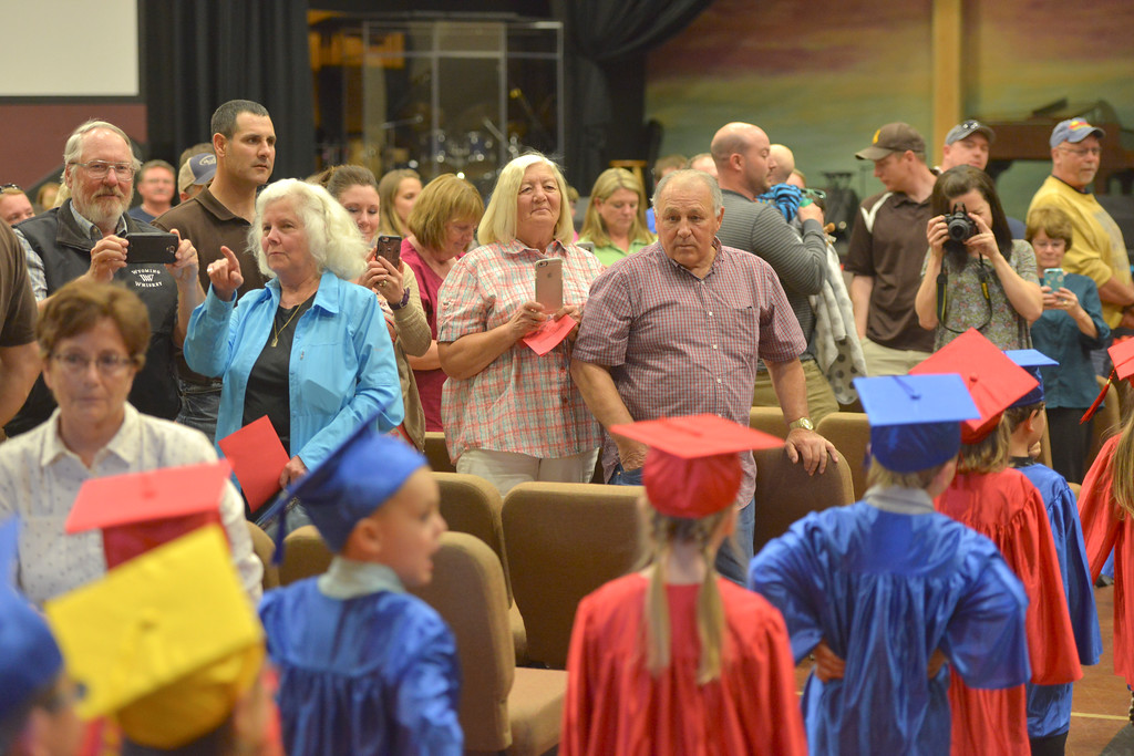Justin Sheely | The Sheridan Press<br /> Family members watch their little graduates march inside during the Children's Center annual Preschool Graduation Tuesday at Sheridan Wesleyan Church. The Children's Center had 35 students graduate, which is the largest group the preschool held.