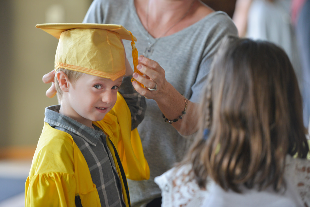 Justin Sheely | The Sheridan Press<br /> Four-year-old Jordan Clark gets ready in the lobby during the Children's Center annual Preschool Graduation Tuesday at Sheridan Wesleyan Church. The Children's Center had 35 students graduate, which is the largest group the preschool held.