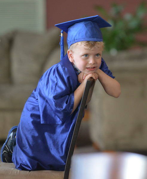 Justin Sheely | The Sheridan Press<br /> Jensen Arnold waits on a chair during the Children's Center annual Preschool Graduation Tuesday at Sheridan Wesleyan Church. The Children's Center had 35 students graduate, which is the largest group the preschool held.