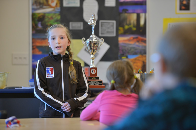 "Justin Sheely | The Sheridan Press<br /> Meadowlark Elementary third-grader Ella Bilyeu shares with her classmates Tuesday morning about her experience in the regional Elks Hoop Shoot competition. Bilyeu represented Wyoming to finish second for 8-9 year old girls in the Elks Hoop Shoot Northwest Central Region competition in Denver on March 11, 2017. This was Bilyeu's first time competing in the free throw competition, which began in Sheridan earlier this winter. After winning, she advanced with five other shooters from Sheridan County to compete in district competition at Casper on January 21. Bilyeu took first in district and later won state in her division. At the regionals in Denver, she made 18 out of 25 free throw baskets, her personal best, but just short of taking first to proceed to the national competition. Bilyeu said that it was a cool experience and encouraged her classmates to compete in the next Elks Hoop Shoot tryouts in Sheridan. ""They were really nice and made me feel special,"" she said. ""I think you could do as well as me."""