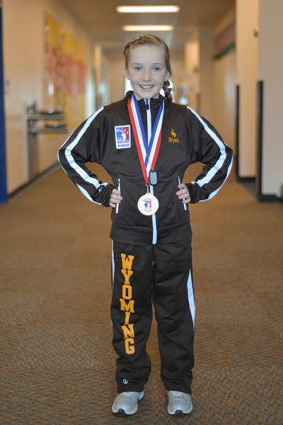 "Justin Sheely | The Sheridan Press<br /> Meadowlark Elementary third-grader Ella Bilyeu represented Wyoming to finish second for 8-9 year old girls in the Elks Hoop Shoot Northwest Central Region competition in Denver on March 11, 2017. This was Bilyeu's first time competing in the free throw competition, which began in Sheridan earlier this winter. After winning, she advanced with five other shooters from Sheridan County to compete in district competition at Casper on January 21. Bilyeu took first in district and later won state in her division. At the regionals in Denver, she made 18 out of 25 free throw baskets, her personal best, but just short of taking first to proceed to the national competition. Bilyeu said that it was a cool experience and encouraged her classmates to compete in the next Elks Hoop Shoot tryouts in Sheridan. ""They were really nice and made me feel special,"" she said. ""I think you could do as well as me."""