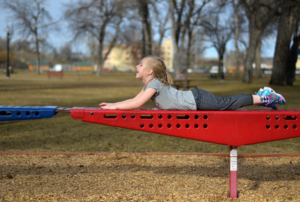 Justin Sheely | The Sheridan Press<br /> Six-year-old Sophia Harnish plays on the playground Wednesday at Kendrick Park. Sheridan residents enjoyed the extra hour of sunshine and a high temperature of 74.